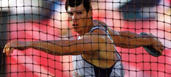 Lance Brooks discus throw at Millikin University